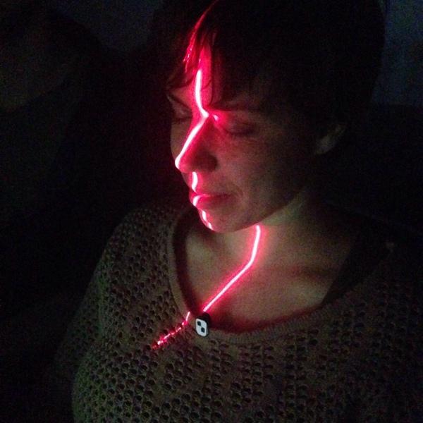 Nina having her face scanned
